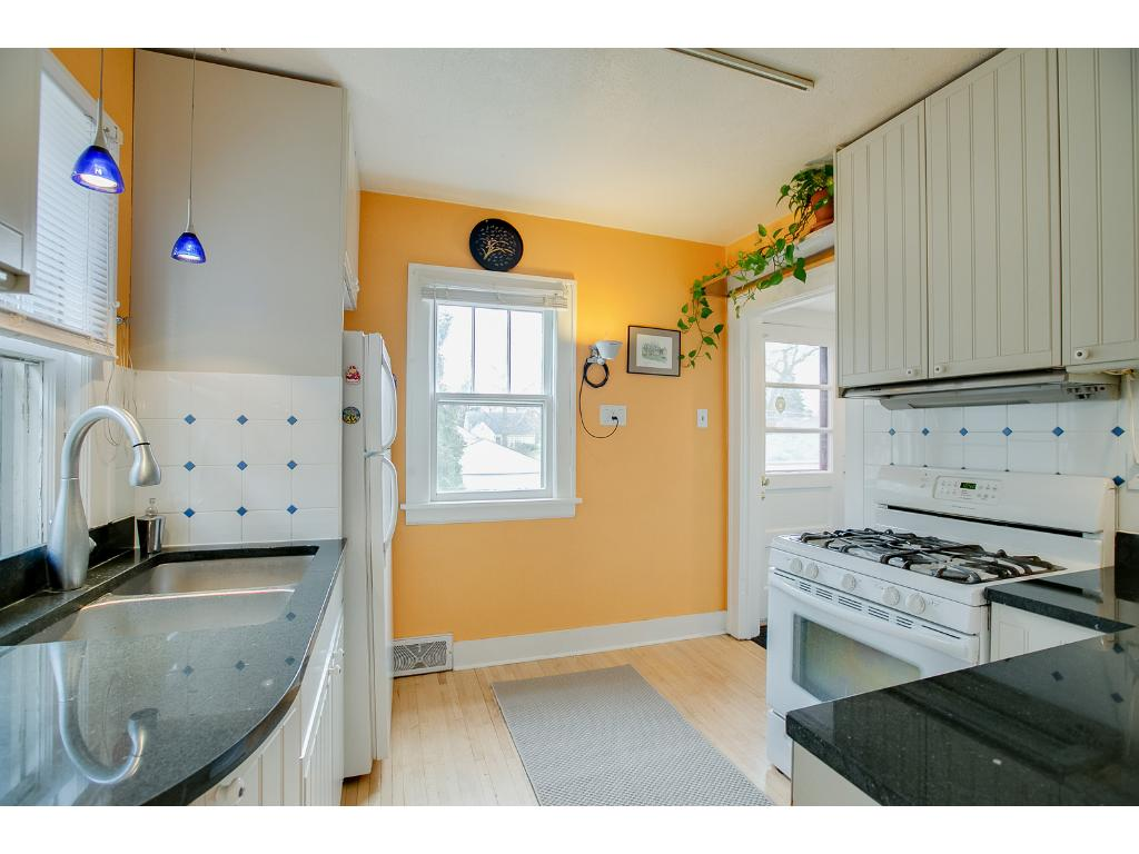 Terrific main floor kitchen features ample cabinet storage space & beautiful hardwood floors!