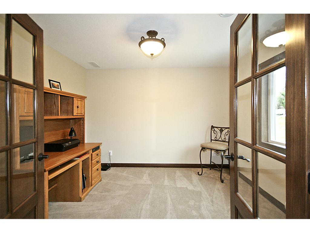 Lower level office with custom French doors.