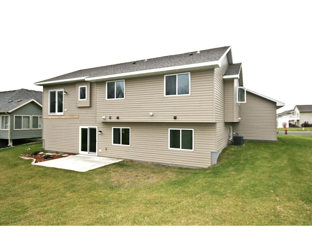 Walk-out basement and patio. 320 sq. ft. insulated and sheet rocked bonus room for extra storage above garage w/stairs.