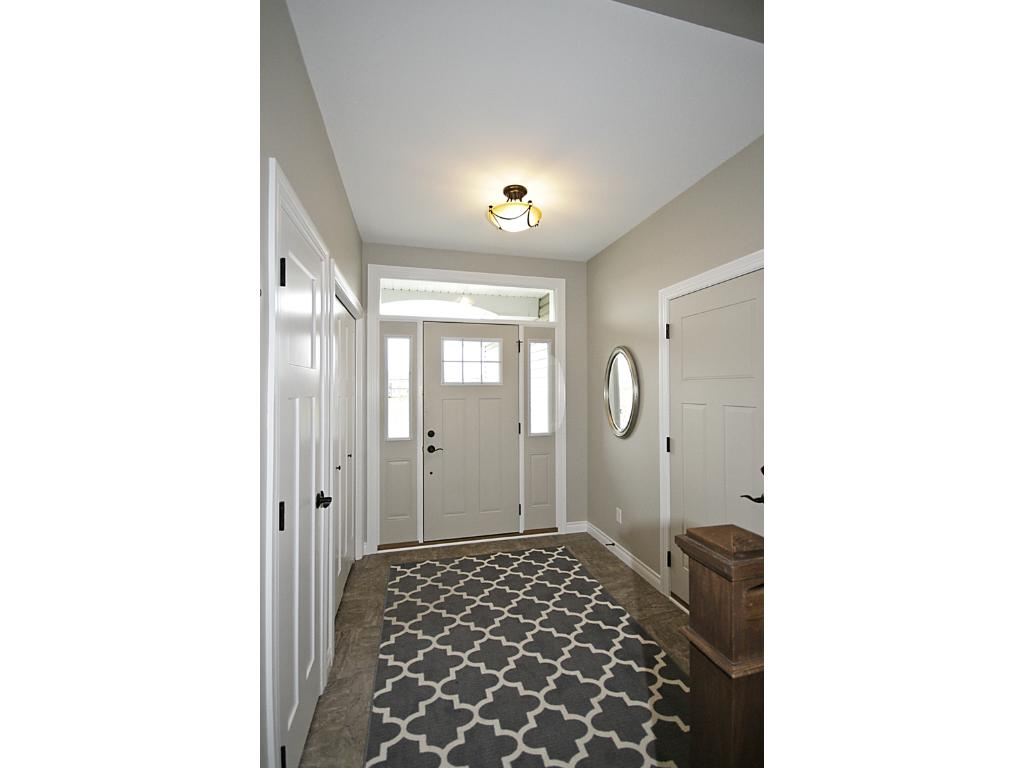 Hand-scraped hardwood floors throughout kitchen, dining room, living room and hall.