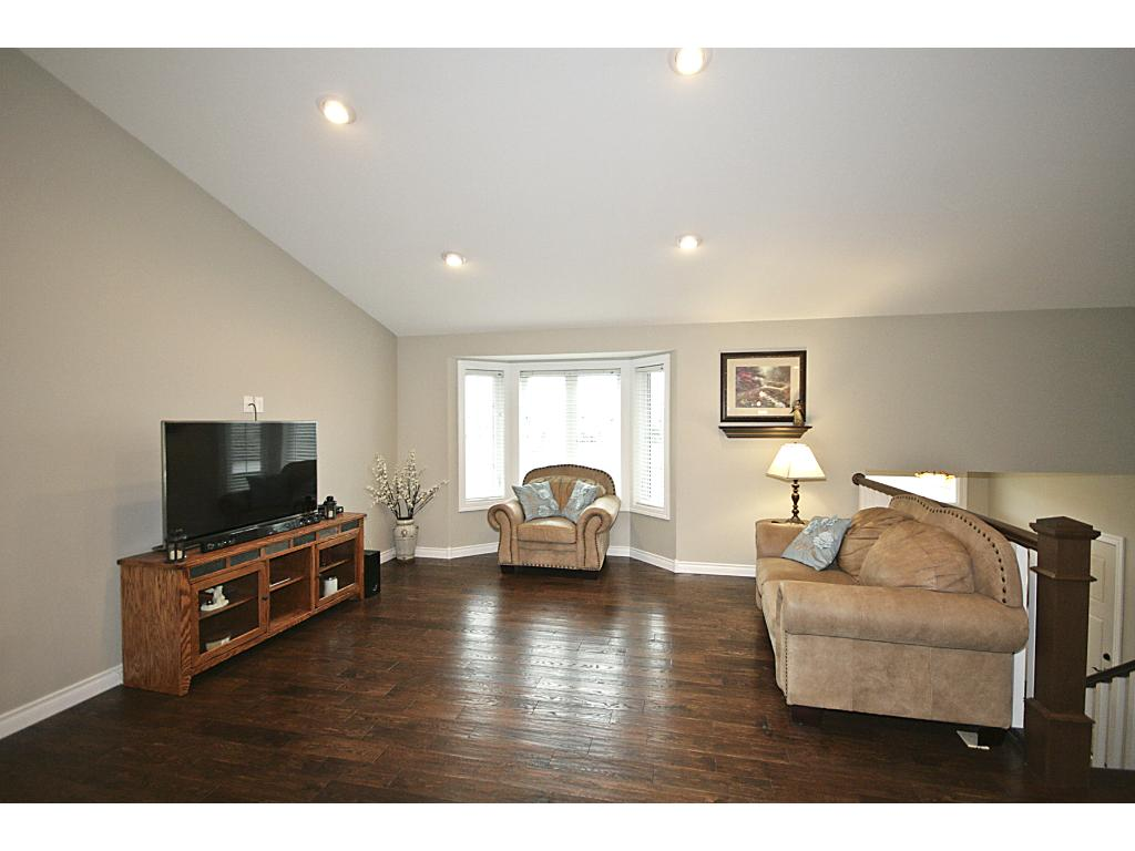 Open floor plan with living room, dining room and kitchen.