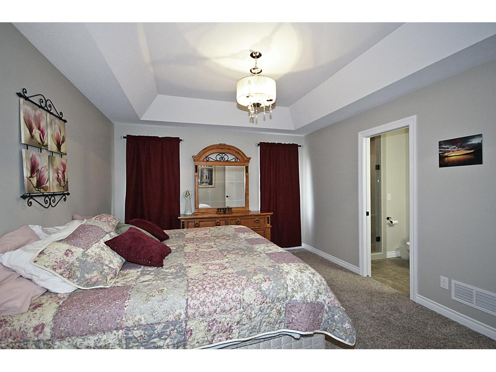 Master bedroom with master bathroom and walk-in closet.