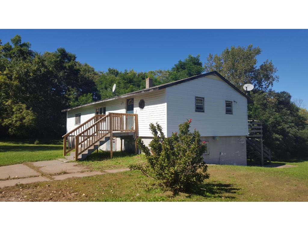 Lots of possibilities with this spacious rambler on a beautiful five acre lot!