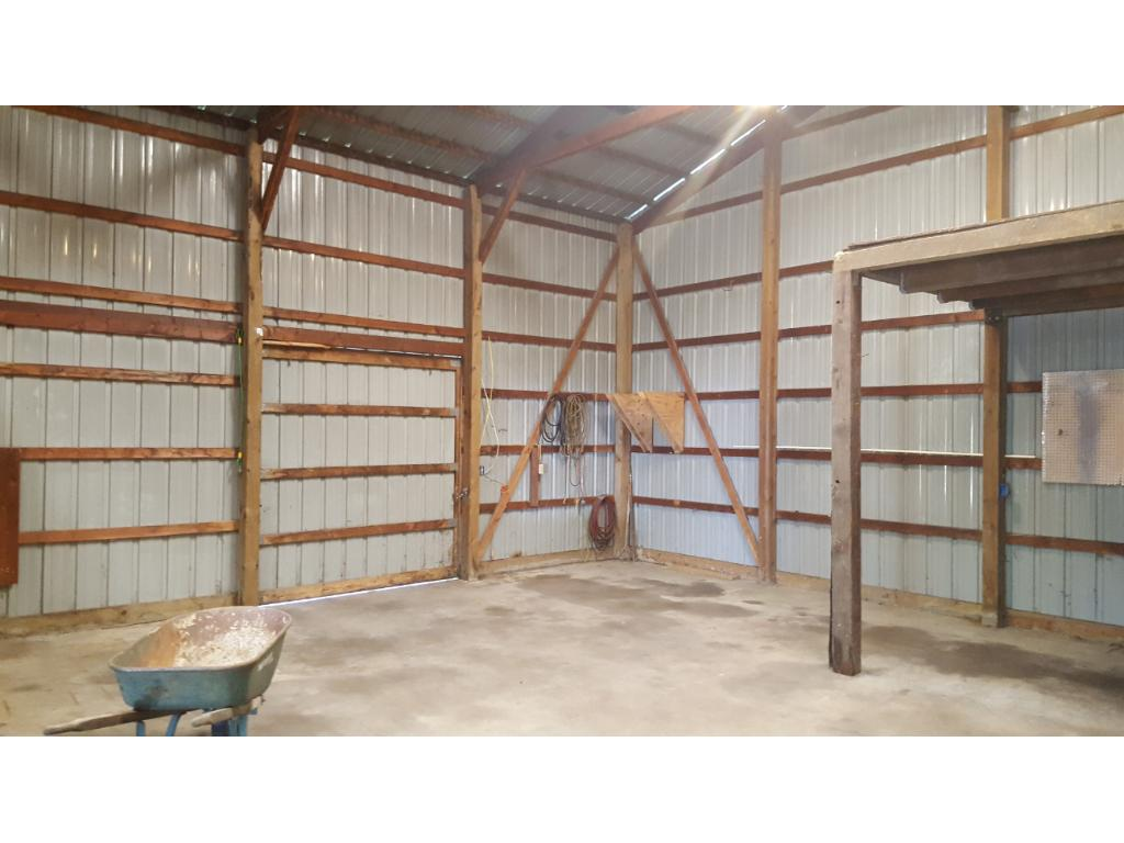 Large 48 x 30 foot pole barn, with concrete flooring and electrical.