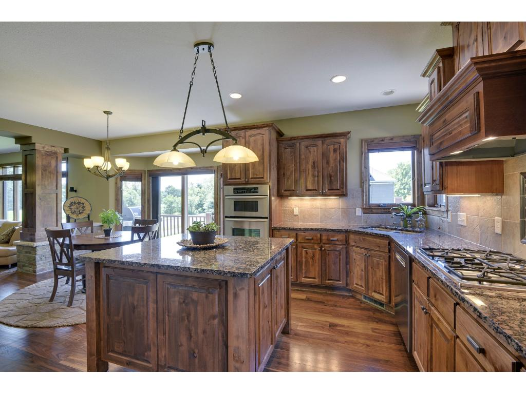 Large island in the kitchen provides an ideal place for meal preparation, serving guests, or grabbing a quick bite to eat.