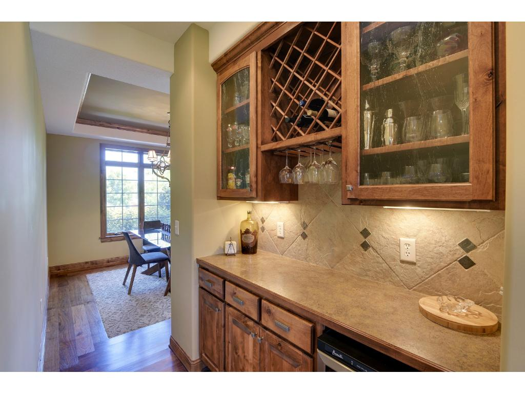 Butler's pantry with wine cooler is a natural transition from the kitchen to the formal dining room.