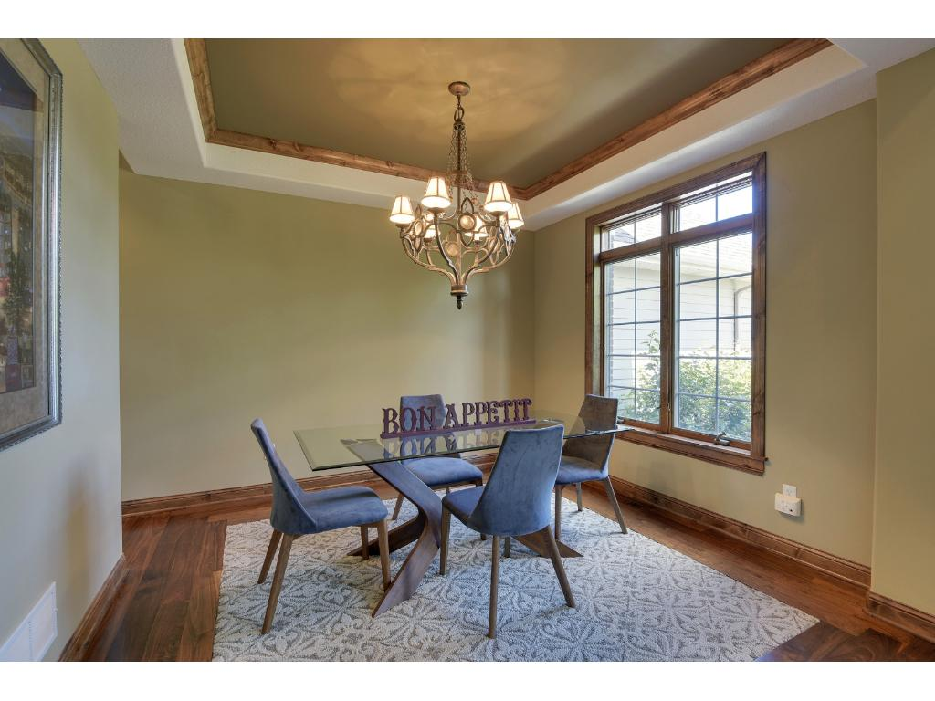 Formal dining room is large enough to entertain guests or could double as an office space if needed.