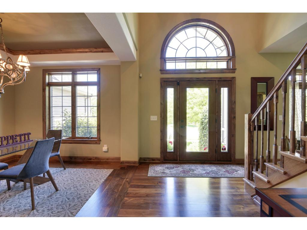 """2-story entrance with 5"""" black walnut flooring throughout the main floor."""