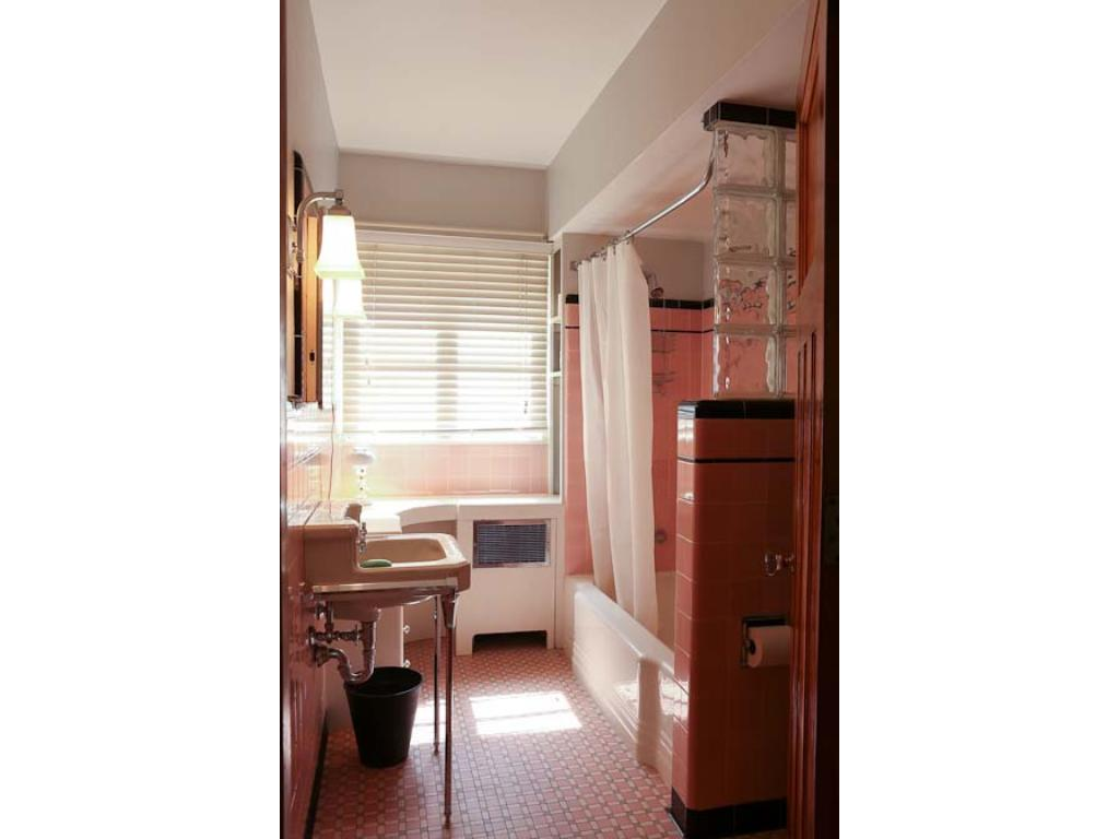 The main floor bath has been updated but retains its original character.