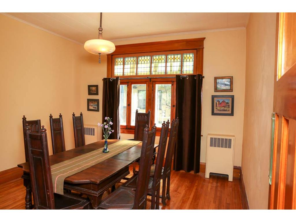 The large formal dining room accommodates any size group.  See the stained glass!