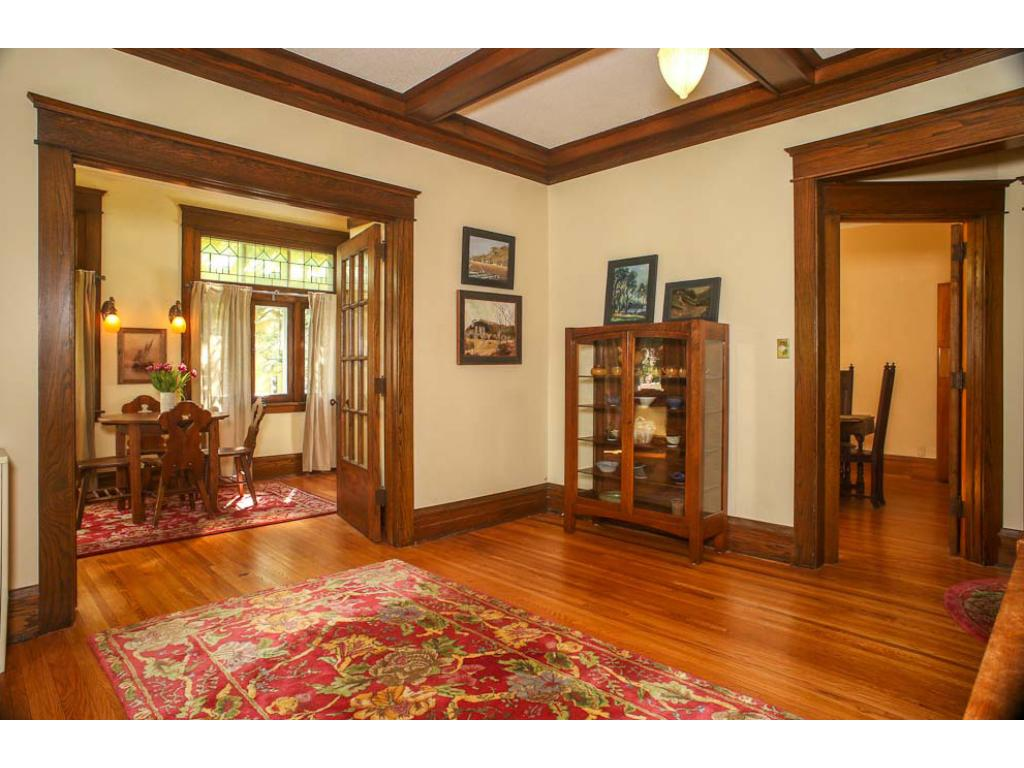 Here is a view from the living room into the dining room on the right and the sunroom on the left.