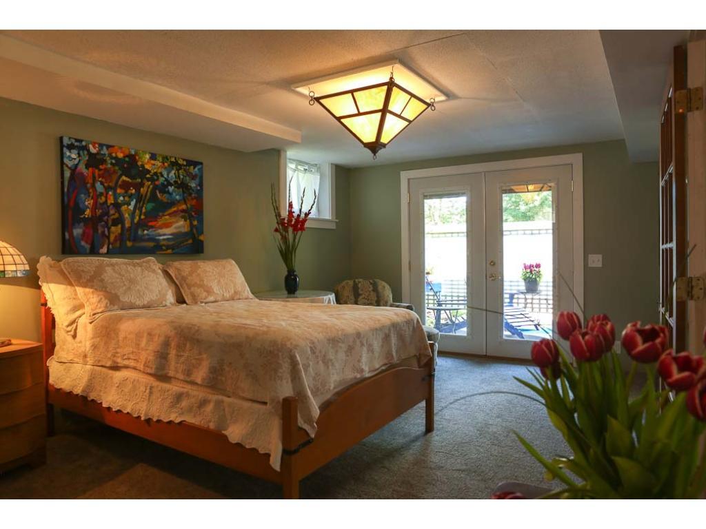Here is the lower level master suite with doors opening to your private patio.