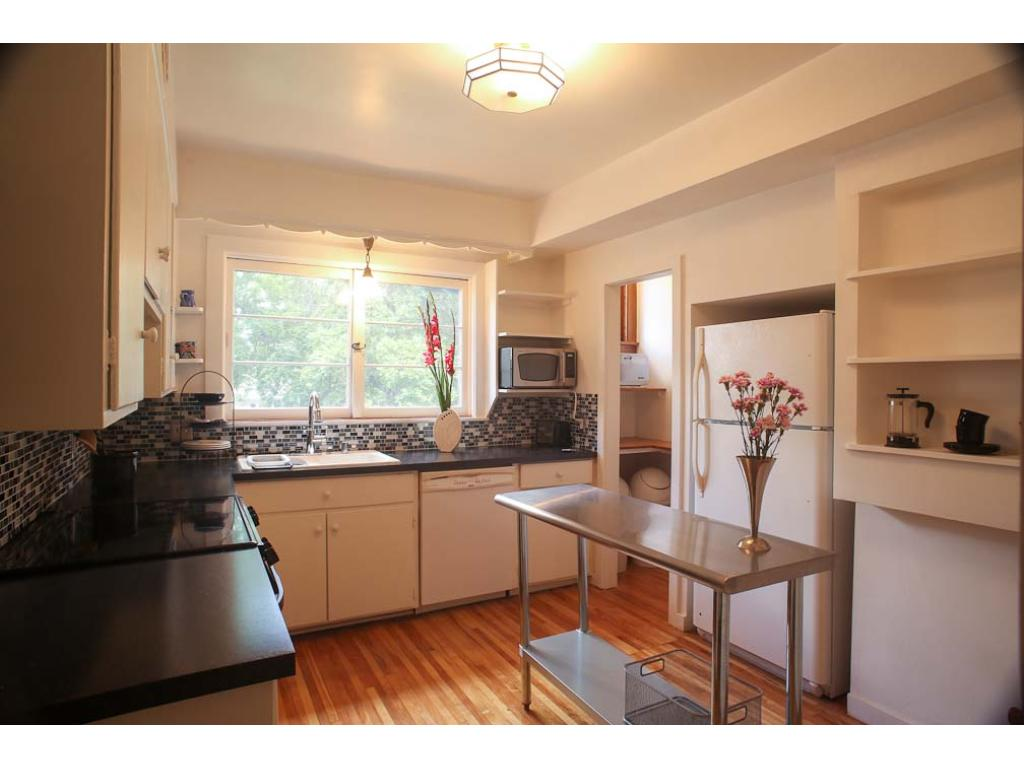 The kitchen has been completely updated and a pantry added.  It is a wonderful use of space.