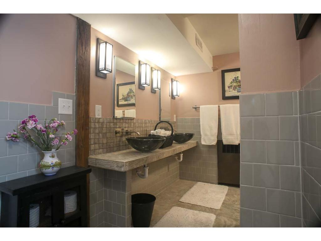 Notice the twin sinks and the period sconces.