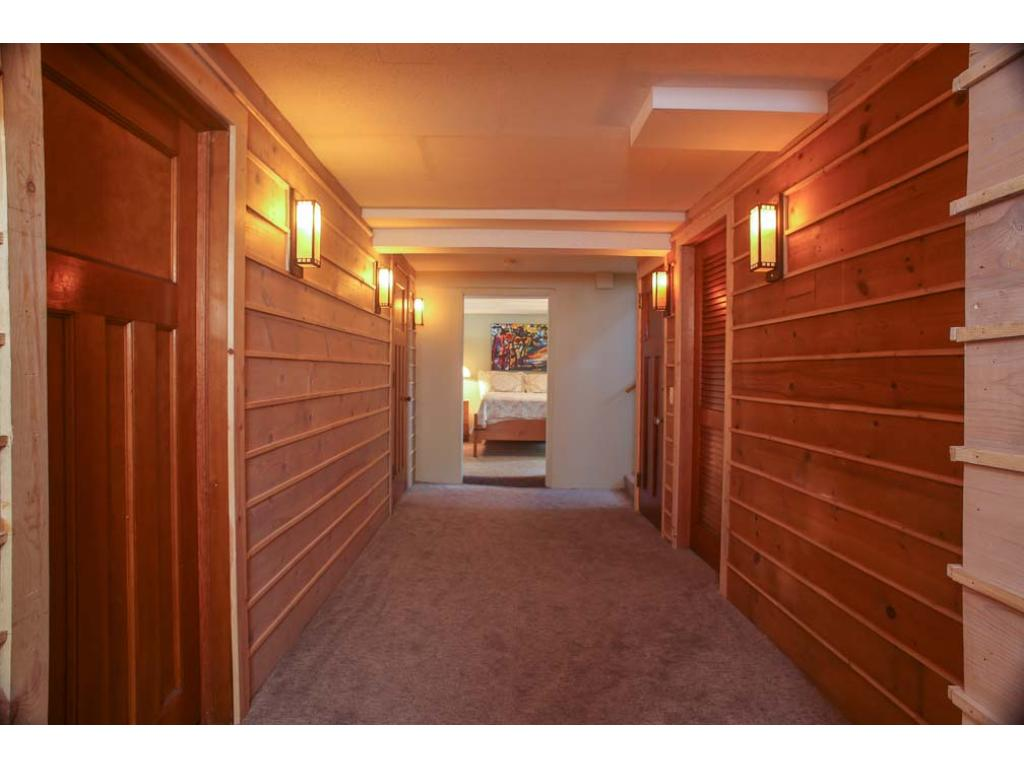 This hallway connects the master suite and the lower level family room.  Notice the beautiful wood and doors.
