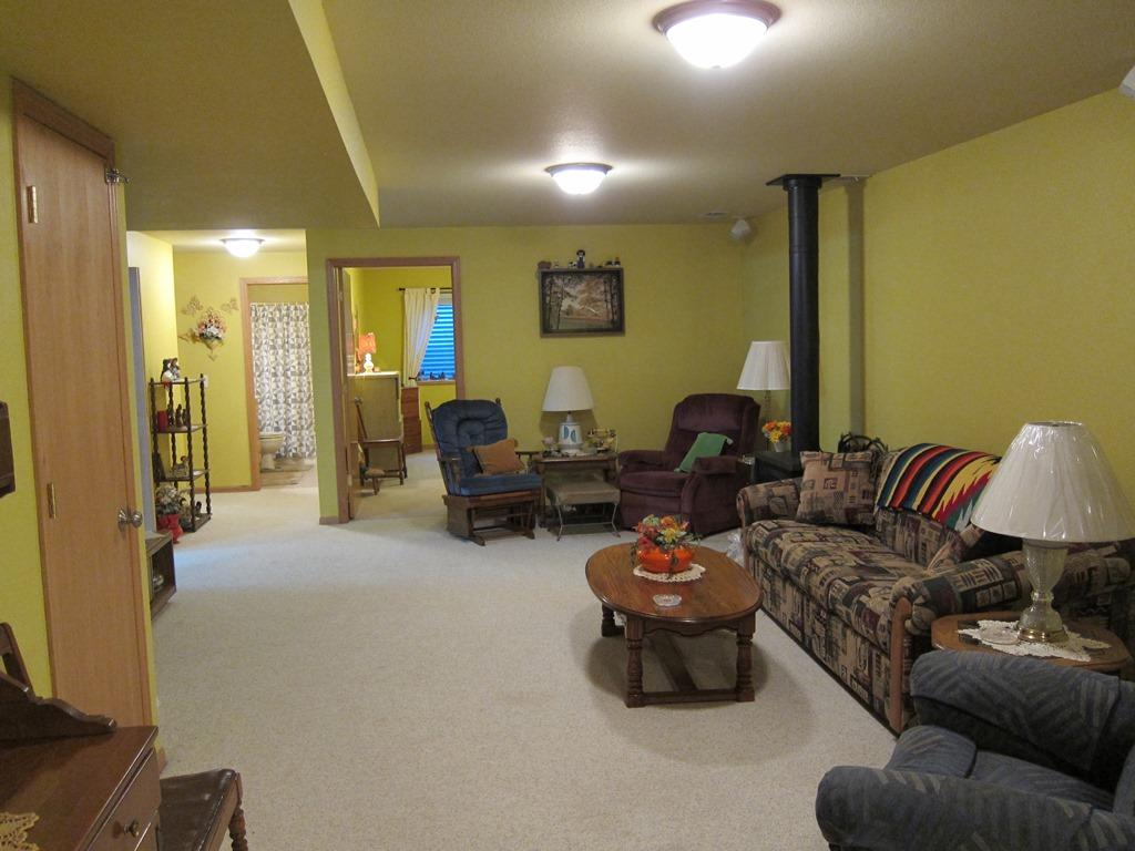 Free standing gas stove keeps this large family room very nice and toasty.