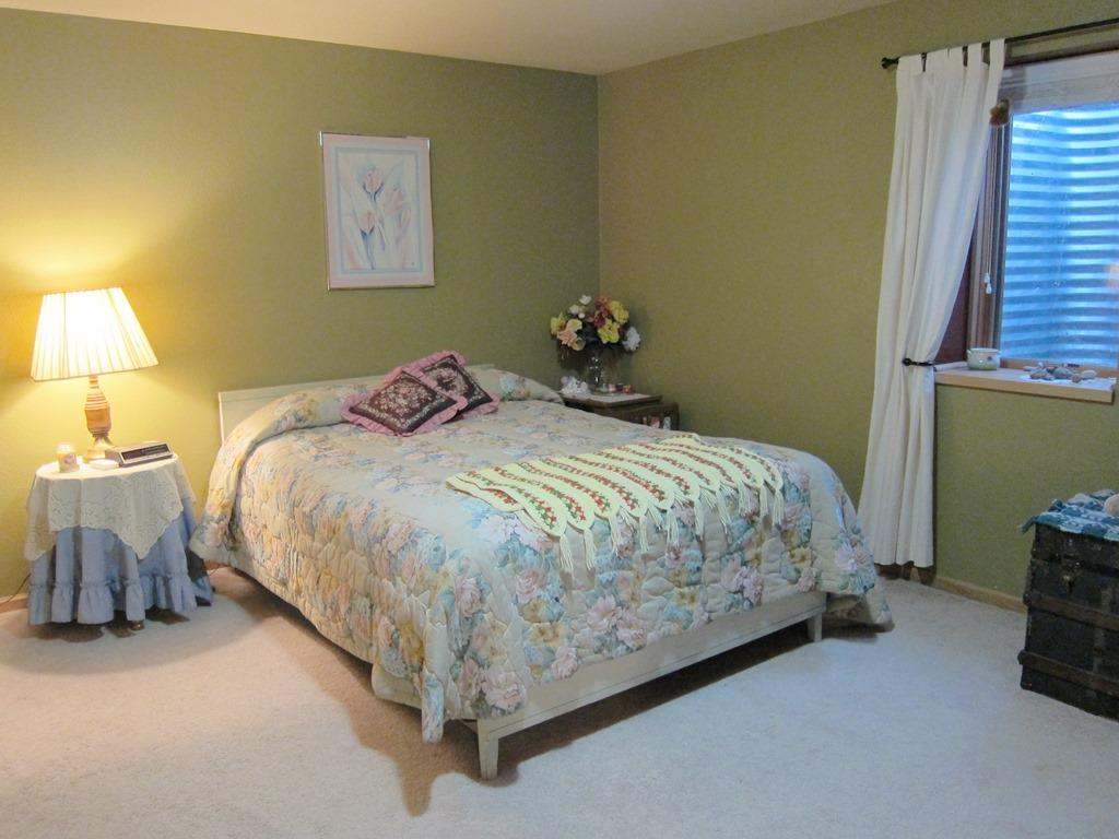 3 main floor bedrooms include the Master suite with a full bath an large double closets, 2 additional bedrooms in the lower level plus 1 full bath.