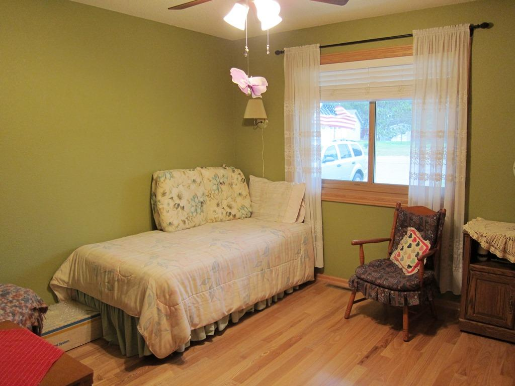 This bedroom could also be used for an office or den.