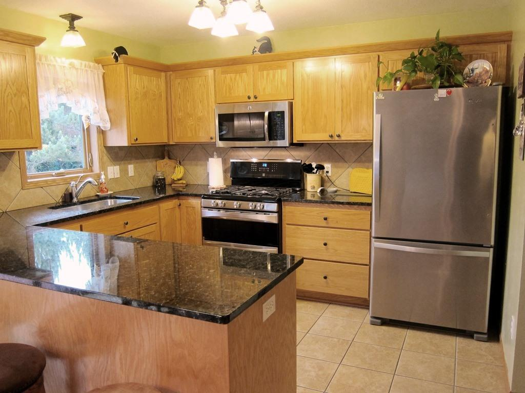 Awesome, updated kitchen with granite countertops, stainless steel, top of the line appliances. Main floor laundry is conveniently located right off of the kitchen.