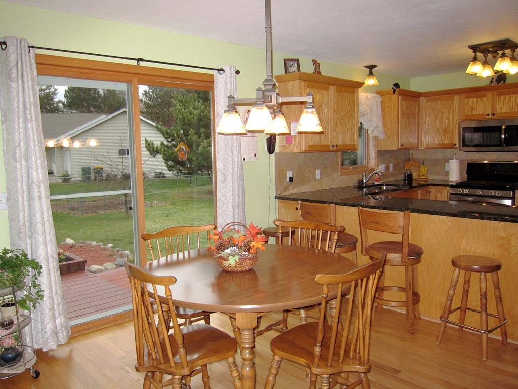 Updated light fixtures, and Beautiful Hardwood floors through out the main floor.