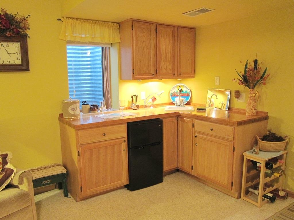 Wet bar and lots of room in the lower level family room for entertaining a crowd. there is also a huge storage room.