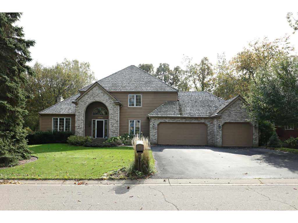 Beautiful 2-Story on wooded lot of a quiet cul-de-sac.