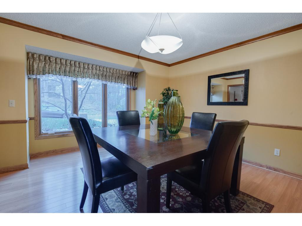 """Dining room is spacious and has new Renewal by Anderson windows as does the entire house.  All the floors in the home are """"carpet free"""" making it a perfect  home to maintain and control allergy dust."""