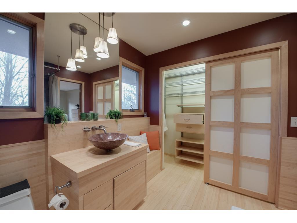 Master closet has custom back lit doors and built in closet organizer.