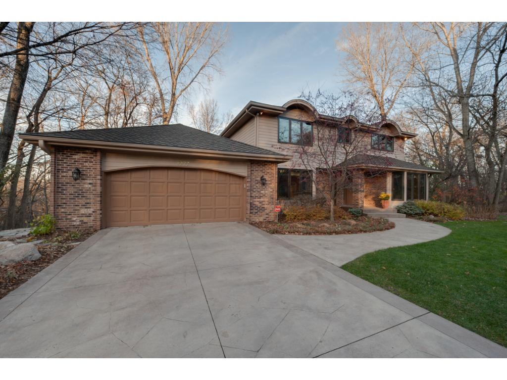 Stamped concrete drive that has been recently resealed.  This beautiful home  has a newer roof, new maintenance free Hardy Board siding, new Anderson windows throughout and newer mechanicals.