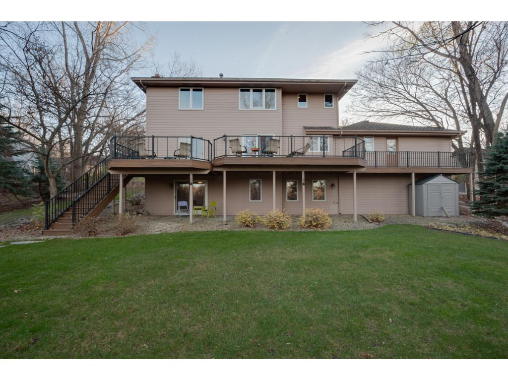 The back yard has a place to play, a woods to discover and it's own pond!  A stunning Trex deck with beautiful railings runs the entire length of the house for all those summer outings. The grounds are landscaped and beautiful for all seasons.