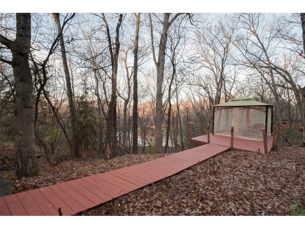 A walkway runs to the outdoor screened gazebo - stunning and private.  A private pond is part of the 1.5 acre property.  Teems with wildlife.  Simply stunning.