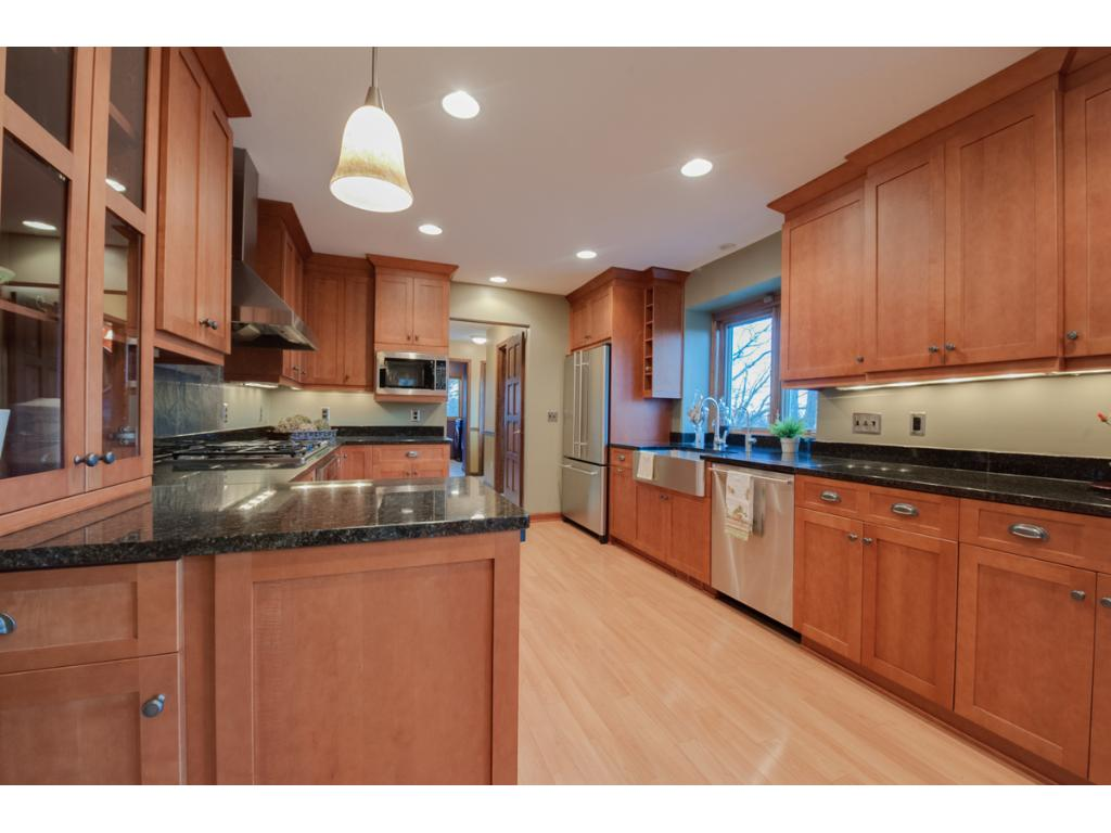 Stunning kitchen with cherry cabinets and top of the line stainless steal appliances.