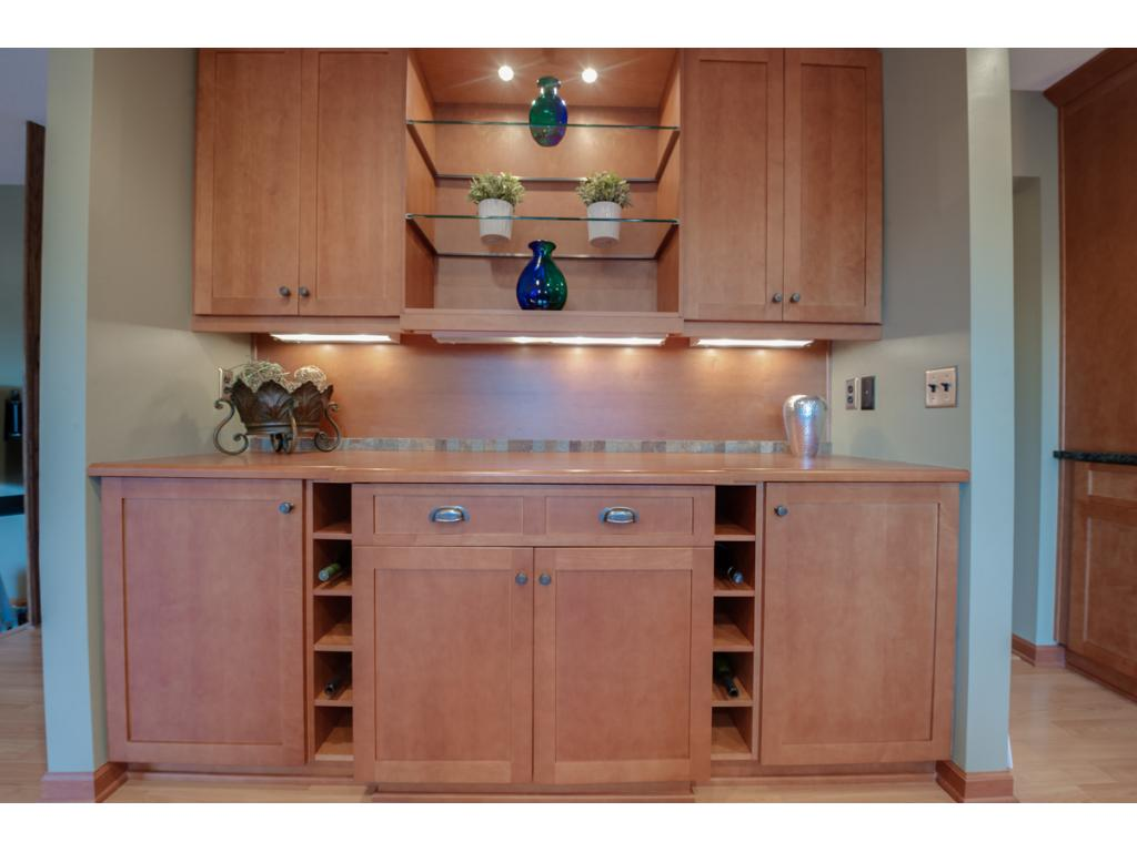 Amazing additional matching storage in the informal dining room and family room.  Includes display area and wine racks.