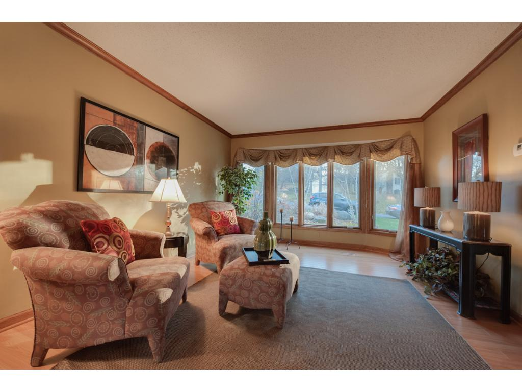 Living room has French doors into the family room and a bay window letting all the light in.
