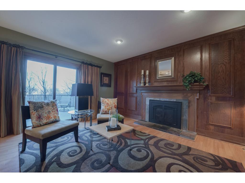 Family room has a new high efficiency gas fireplace insert, new Pella doors that walk out to the most fabulous maintenance free deck with stunning views to the more than one acre back yard.  The home has 8 panel doors throughout.