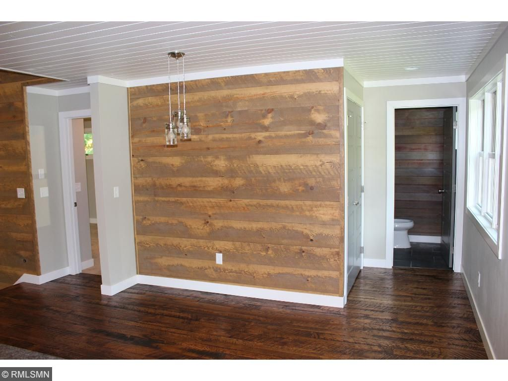 The dining room is just off of the kitchen and features a reclaimed Shiplap accent wall.