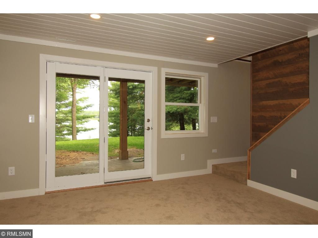 Walkout lower level family room is located lakeside and has access right out to the lakeside patio.