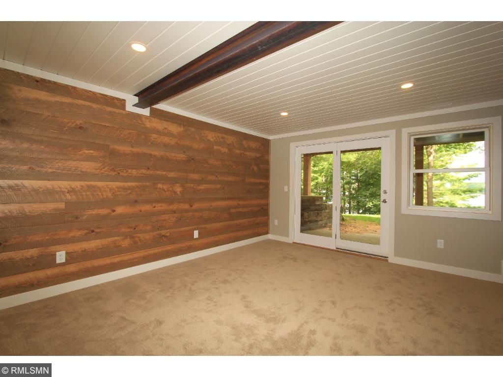 Family room also features a shiplap accent wall along with an industrial beam on the ceiling.