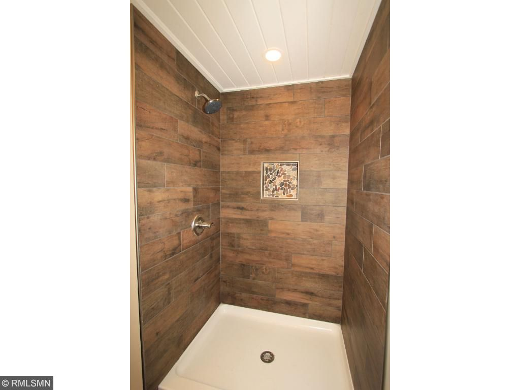 Lower level bathroom has stunning tile work also in the shower.