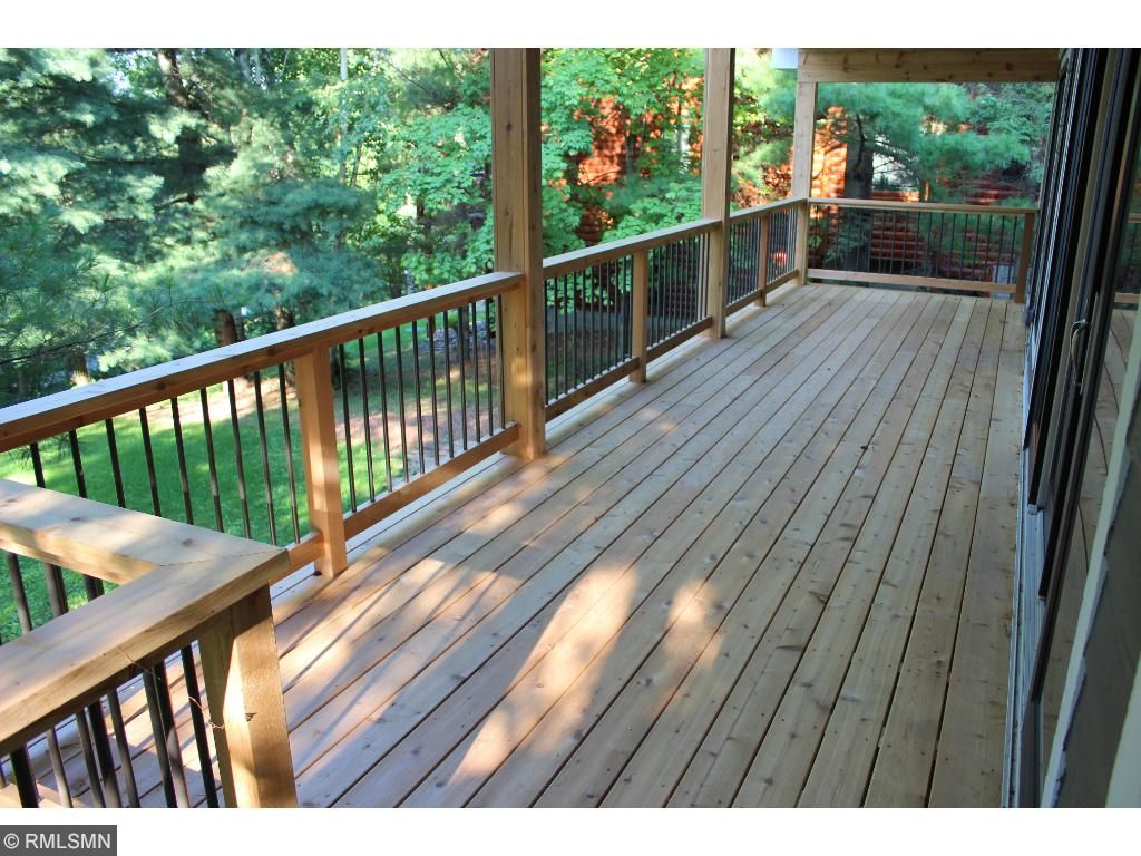 Lakeside cedar deck has stairs to the lake.