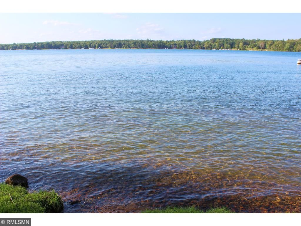 Property situated on a fabulous 60 foot lot that has moderate elevation and a sand beach on the famous Whitefish Chain. Sit back and relax at the lakeside beach and take the warm summer sun.