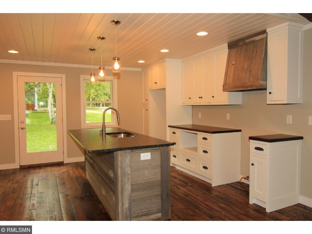 Updated kitchen has custom cabinets with a Black Walnut countertop and Oak hardwood floors.