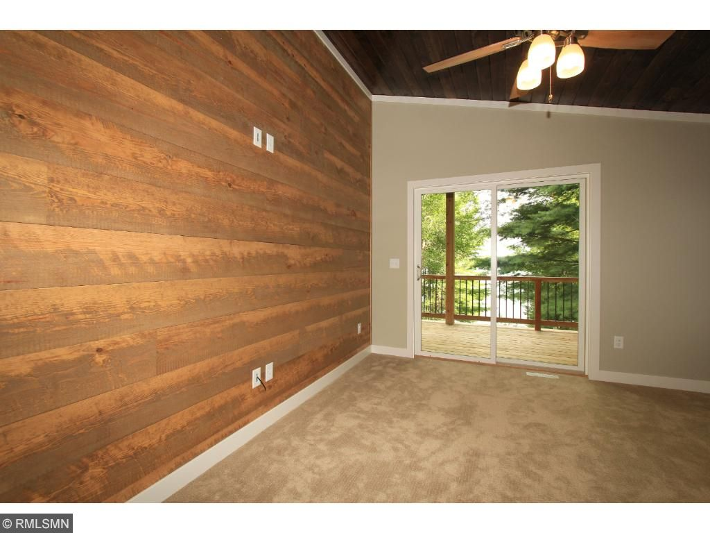 Lakeside master bedroom suite offers stunning views of the lake, access the lakeside deck and a walk-in closet.