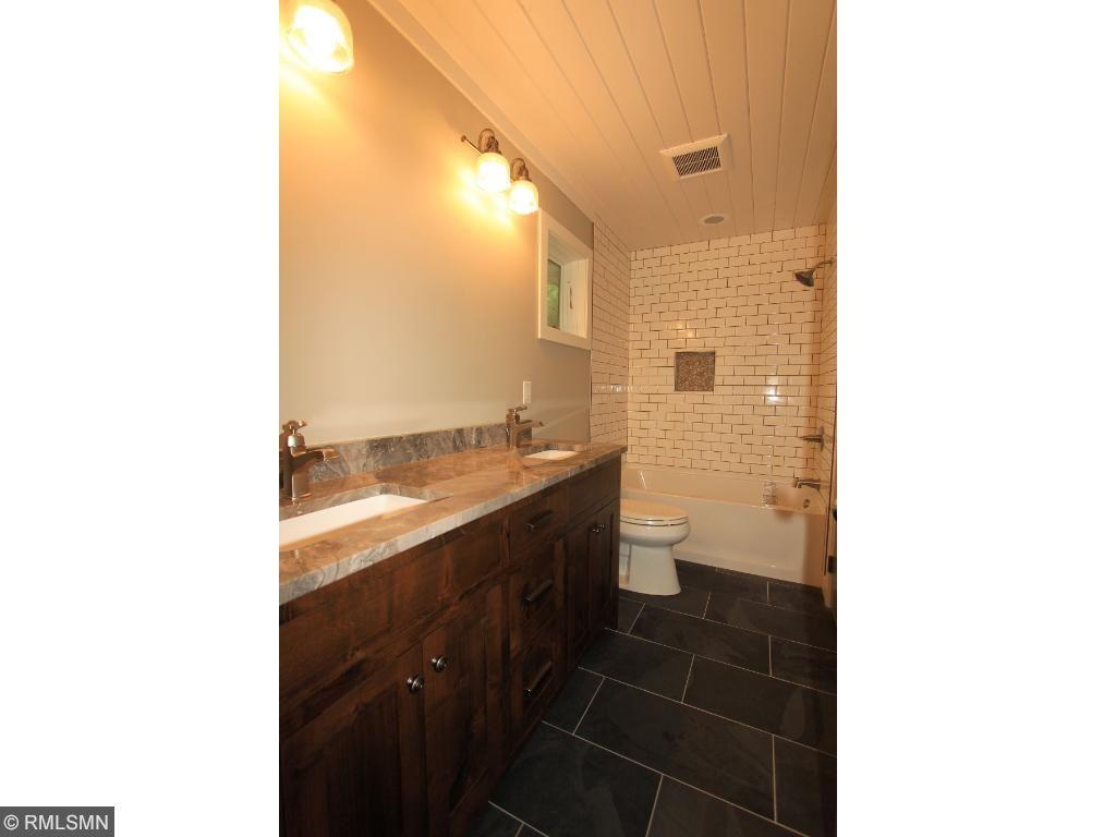 Master bedroom bathroom has custom Knotty alder vanity along with custom tile work throughout.