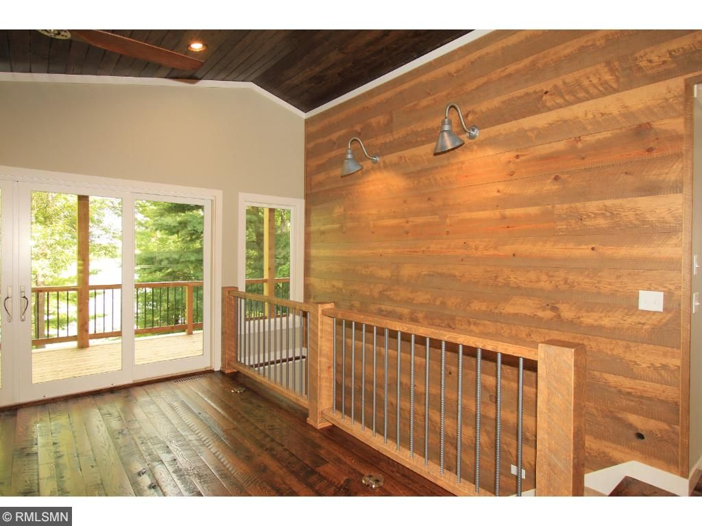 Lakeside living room features a reclaimed Shiplap accent wall that runs along-side the stairs to the lower level.