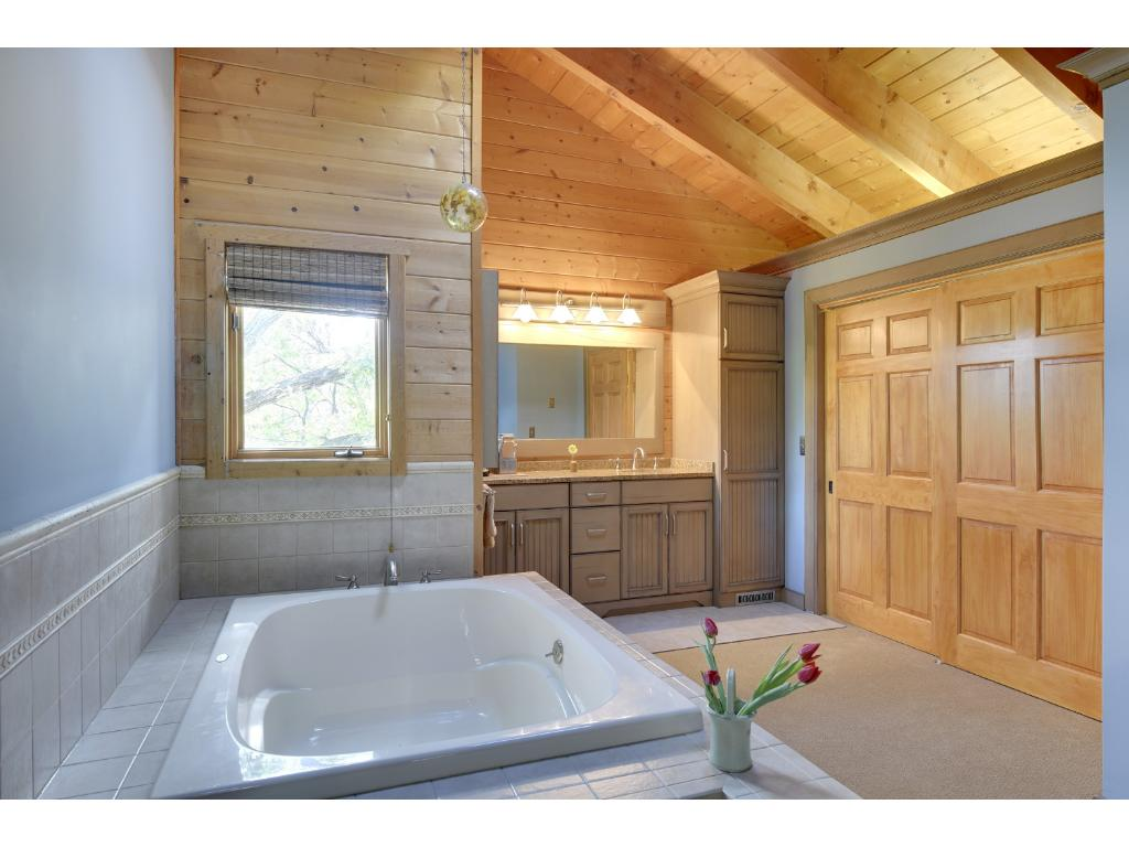 Enjoy a quiet bath in this large soaking tub.