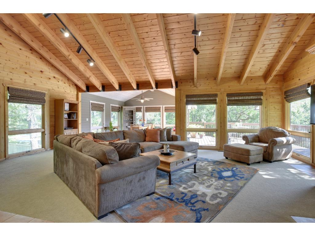 Relax in this huge family room with a fireplace and gorgeous vaulted ceilings.