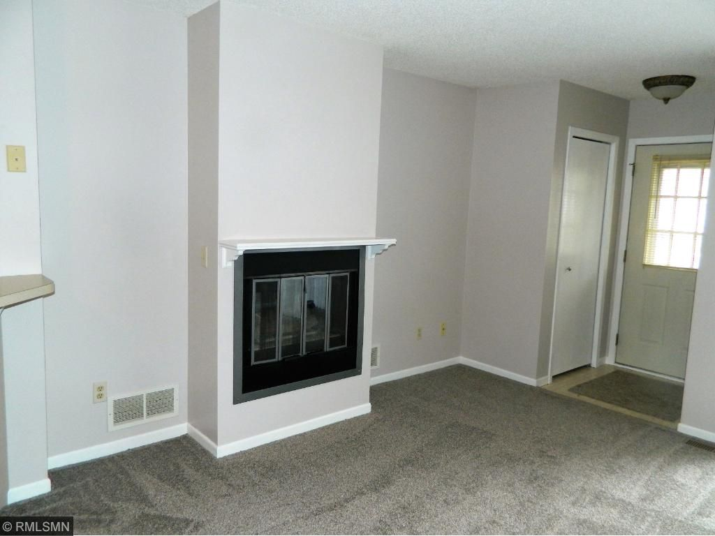 Gas fireplace with new mantel.