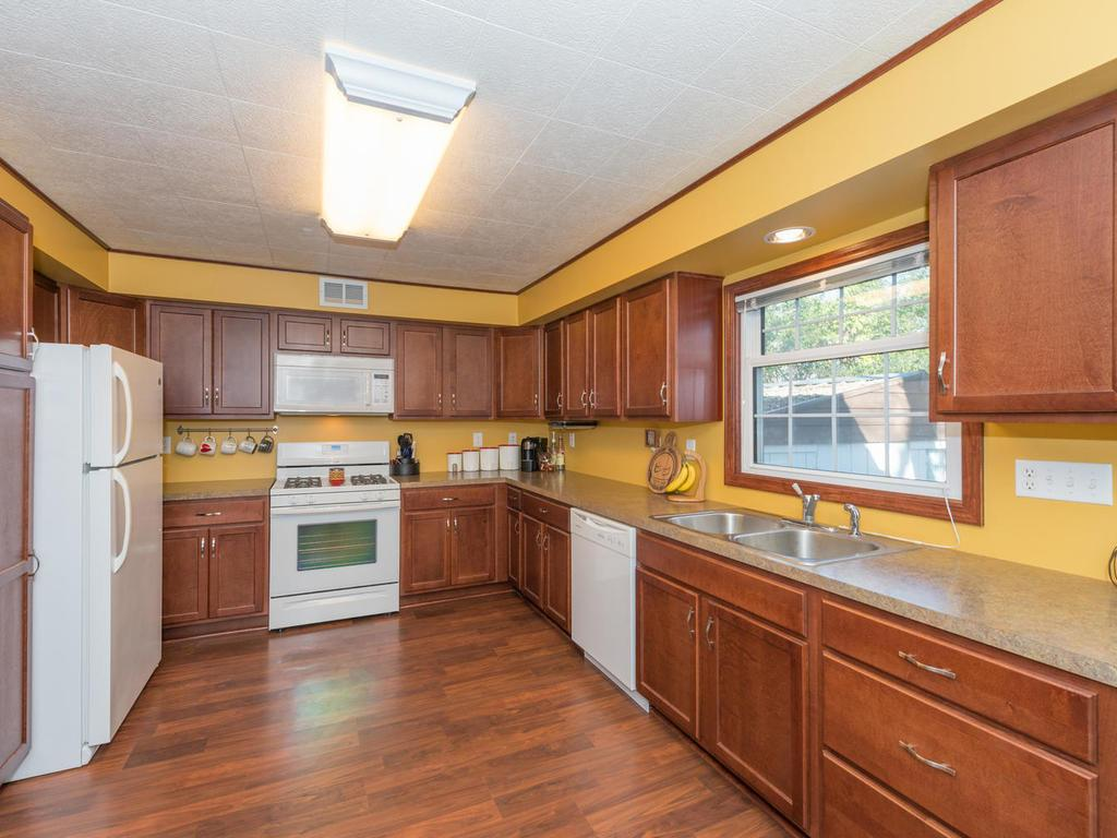 U shaped spacious kitchen area with generous cabinet storage.