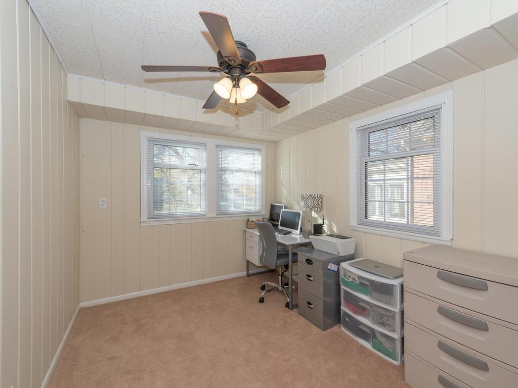 Secondary bedroom space with closet.  Currently used as an office.